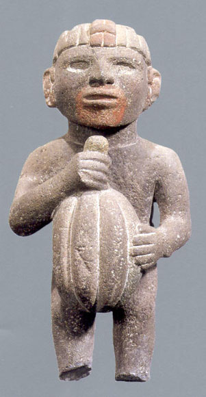 Aztec volcanic stone sculpture, man holding cacao pod (Image in public domain)