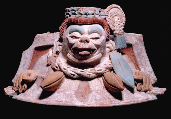 Ceramic cacao vessel lid from Tonina, cacao beans guarded by monkey (Photo in public domain) Maya Exhibition, Canadian Museum of Civilization, Gatineau