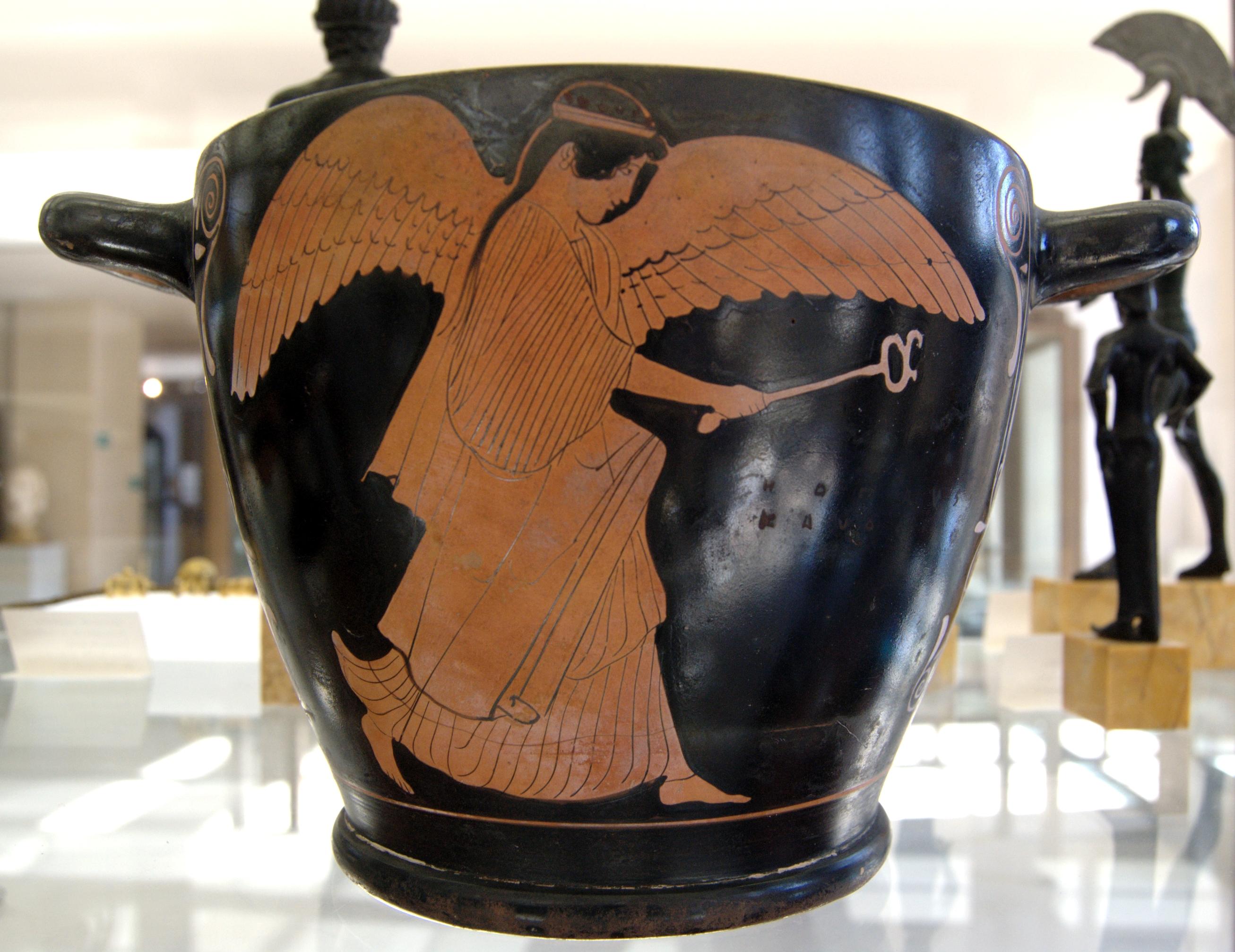Greek Winged female figure holding a caduceus, Attic red-figure skyphos, middle of 5th century BCE. Penthesilea Painter, Cabinet des Médailles, Paris (Photo in public domain)