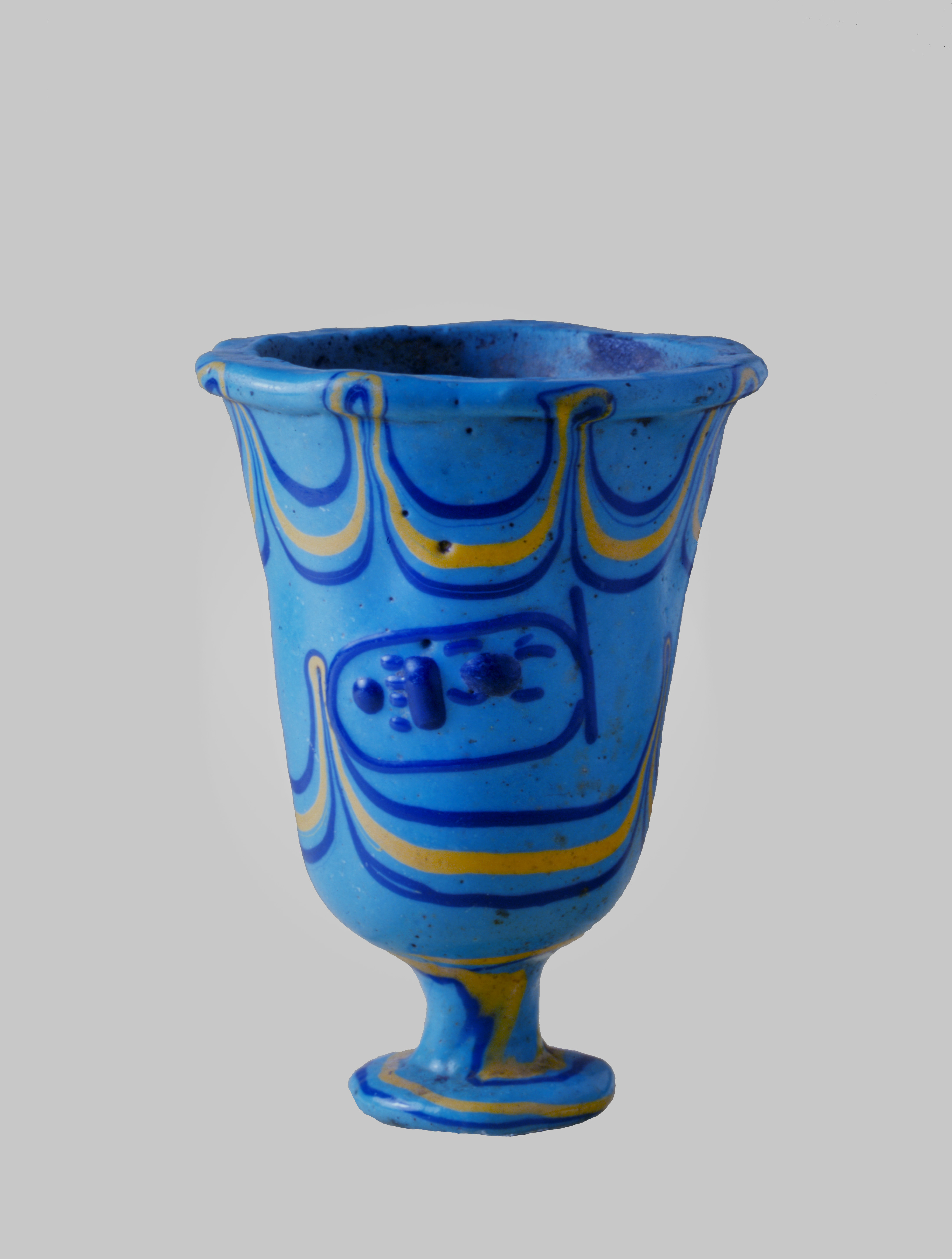 Fig. 8 Glass beaker, light blue glass, Thebes, New Empire, 18th Dynasty, reign of Thutmosis III., c.1450 BC.