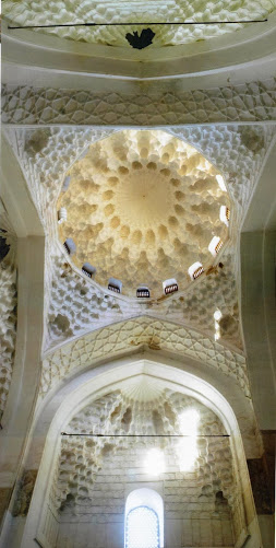 "Interior of dome of Khoja Ahmad Yasawi Mausoleum with muqarna - ""honeycomb"" - decorations (Image in public domain)"