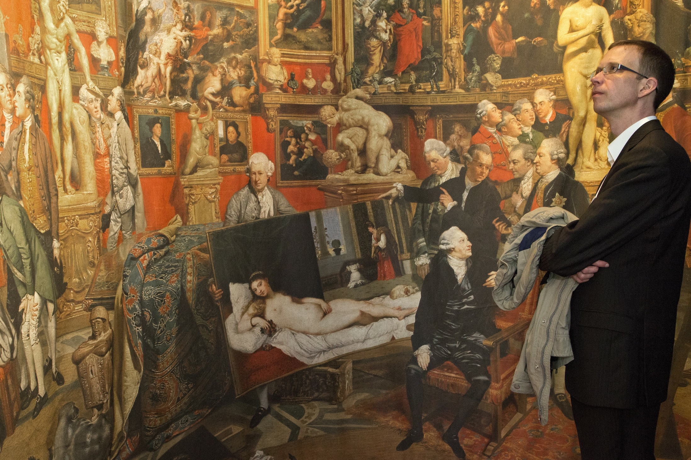 Fig. 6 Inside the Wallmoden exhibition, visitor next to an enlarged reproduction of Zoffany's painting of the Tribuna
