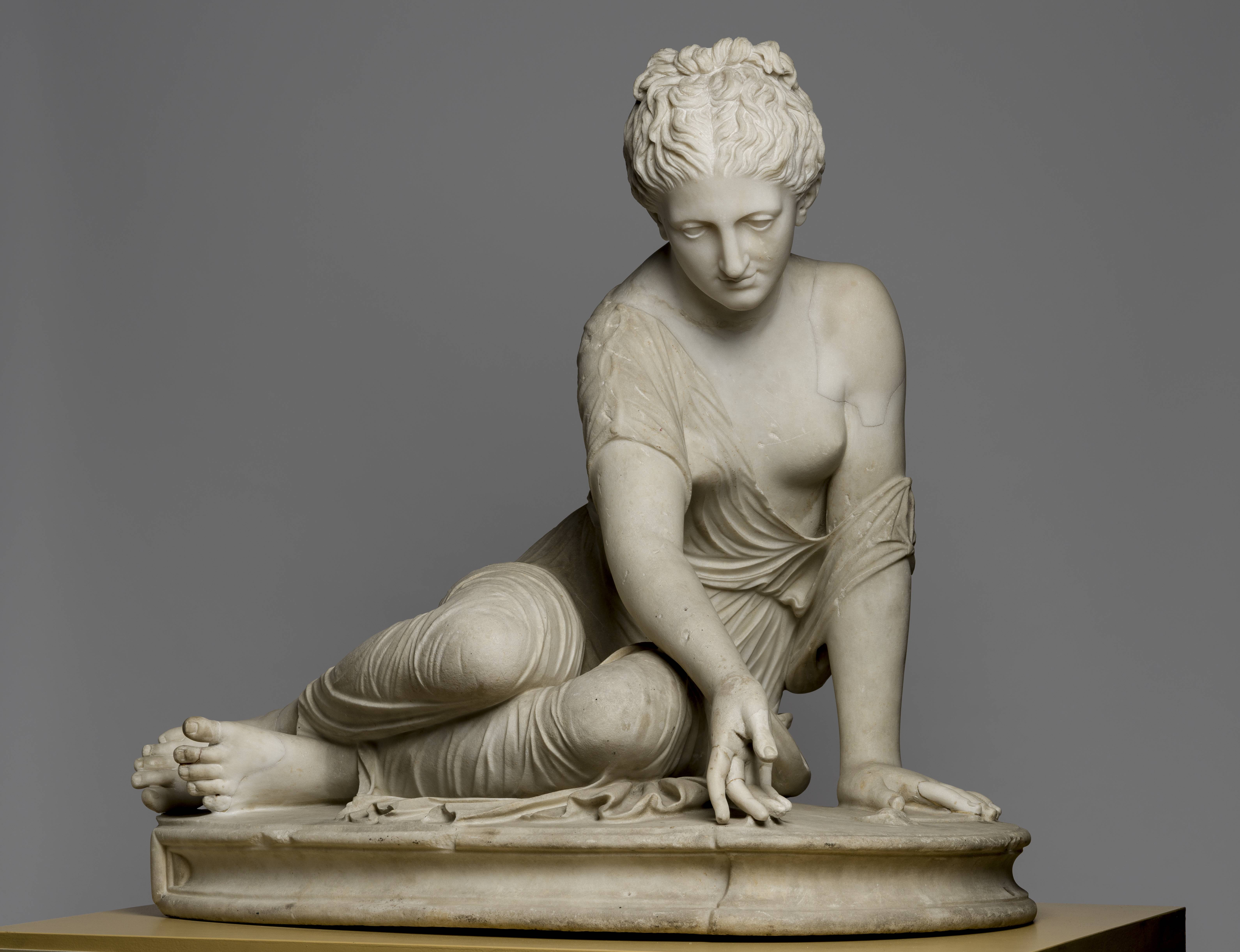 Fig. 8 The Knuckle Bones Player (a nymph from the train of Artemis/Diana), Roman copy of a lost original from the High Hellenistic period, marble, 68.5 × 70 × 47.4cm, found in the Vigna Verospi on the Pincian Hill in Rome in 1765, additions by Bartolomeo Cavaceppi, HRH Ernst August, Hereditary Prince of Hanover, Duke of Brunswick and Lüneburg