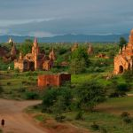 Bagan, Myanmar (Burma), a monk walks by temples (Photo courtesy of National Geographic Images)